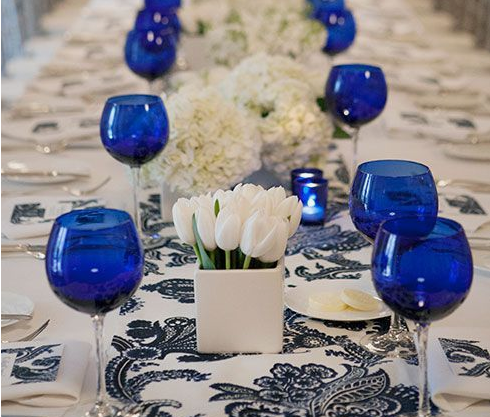 Cobalt blue wine glasses and table runner on white